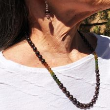 Diana wears black pearl tourmaline necklace and earrings