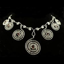 Seven-Spiral-woven-silver-and-garnet-necklace