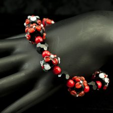 Lamp work bead bracelet in red and black flowers