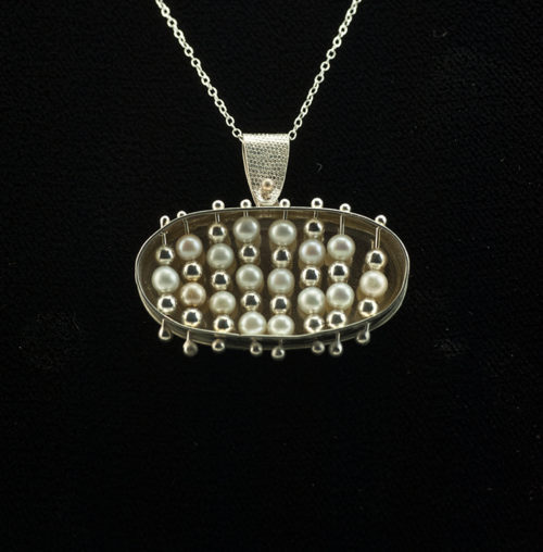 oval silver and pearl pendant