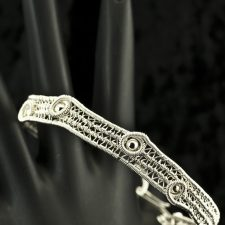 woven silver bracelet with beads