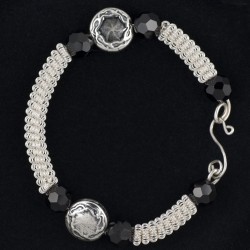 Coiled Silver bracelet with Silver Disk Beads