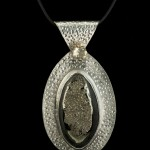Pyritized ammonite in silver with citrine