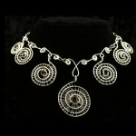 Necklace-7 woven silver spirals with garnets2