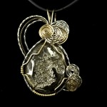 Pendant-ammonite cab set in silver and gold for web