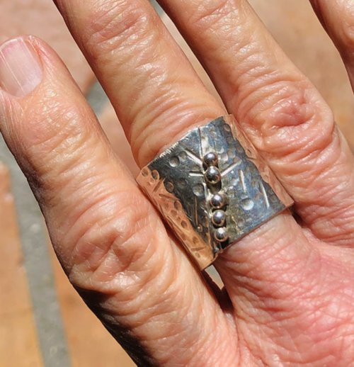 Wide hammered silver ring with granulation