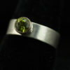 wide silver stacking ring with peridot