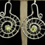 Earrings-Peridot in woven silver spirals_1