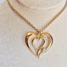 Avon Gold tone heart necklace