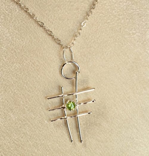 Abstract peridot and silver pendant