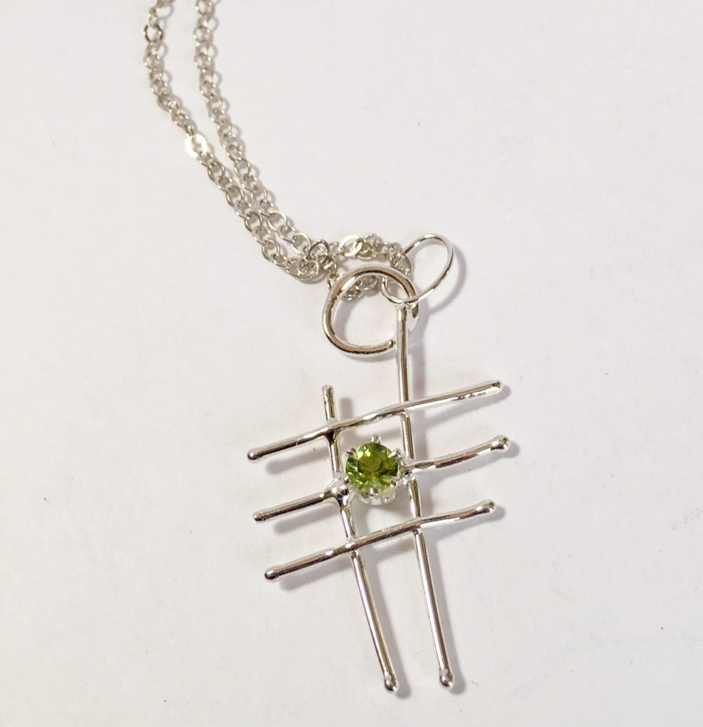 Sterling silver abstract pendant with Peridot