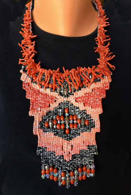 Coral, peach and black woven necklace with coral beads