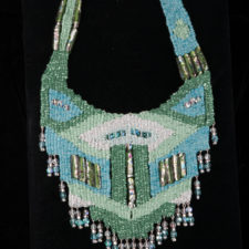 Turquoise and teal woven necklace with lamp work beads
