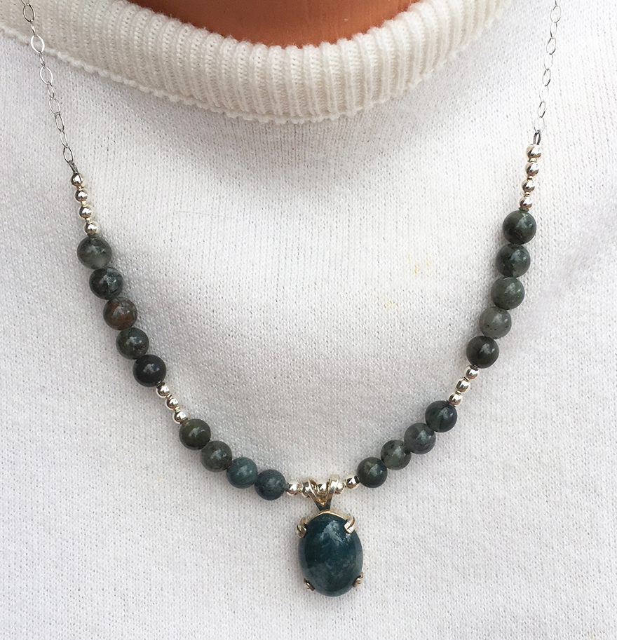 silver tel set bezel product with turquoise stone in sho moss agate necklace