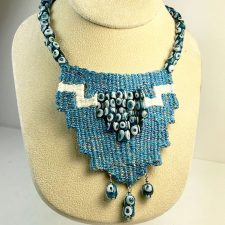 woven fiber evil eye necklace