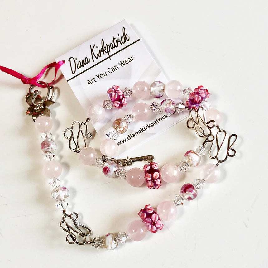 necklace of pink lampwork and rose quartz beads