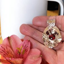 Silver flower pendant with garnet and coffee cup