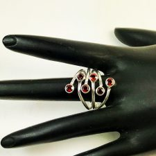 garnet and silver bypass ring