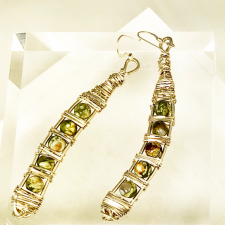 curved gemstone and silver earrings