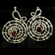Woven spiral silver earrings with garnets