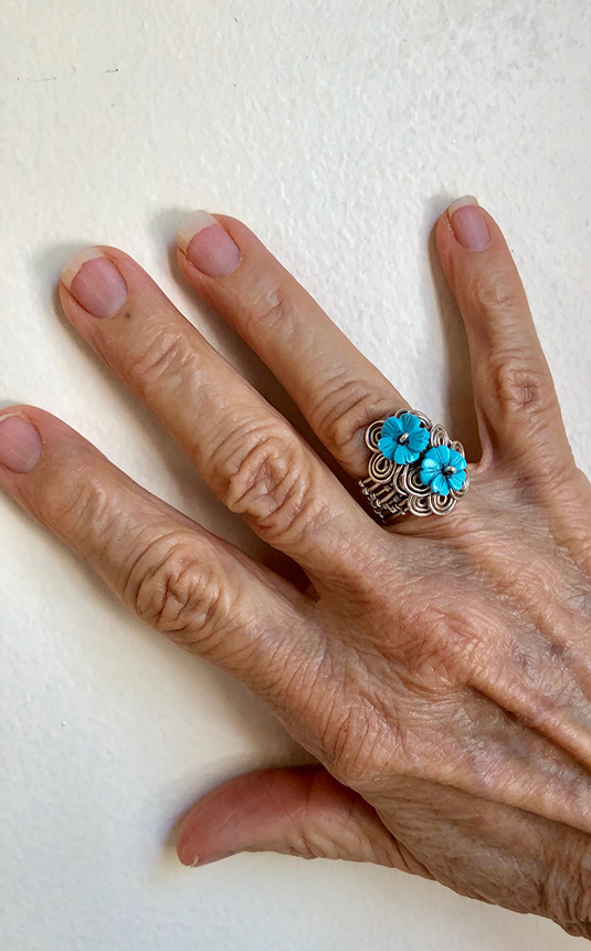 Woven silver ring with carved turquoise flowers