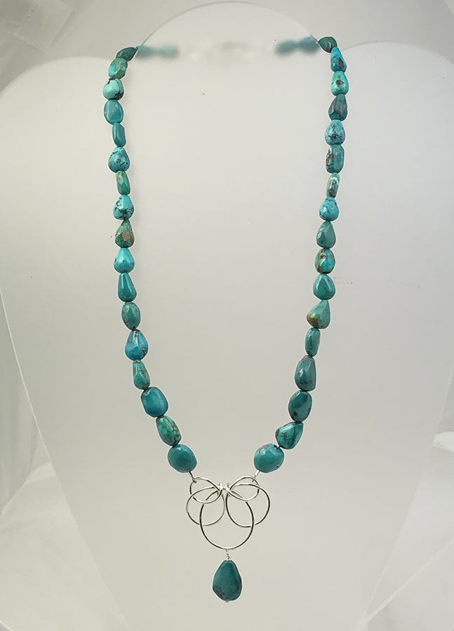 Turquoise bead necklace with sterling silver pendant