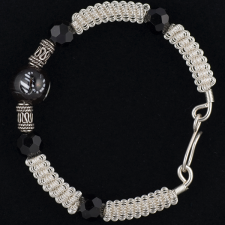 coiled silver bracelet with black onyx beads