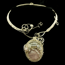 Woven silver necklace shown with a rose quartz pendant
