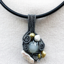 woven silver patinated pendant with moonstone and pearls