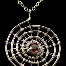 woven silver spiral pendant with garnet