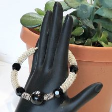 Coiled silver and onyx bangle with plants