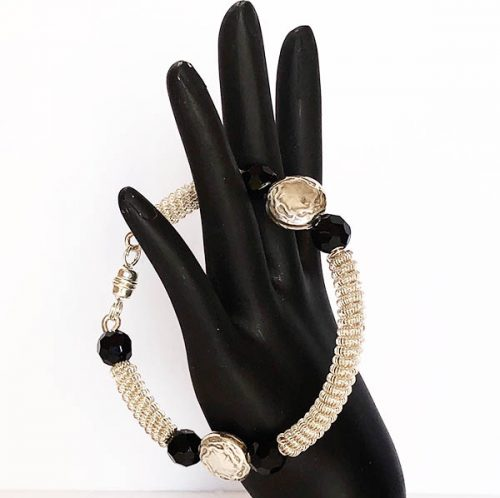 Coiled silver bangle with silver disk beads and onyx
