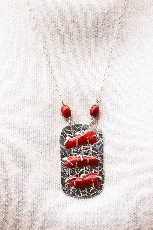 Textured silver pendant with prong-set Coral