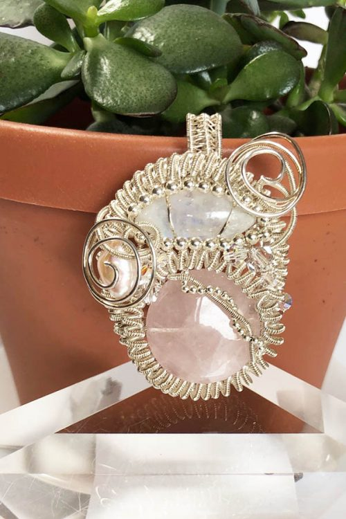 Rose quartz woven silver pendant with moonstone