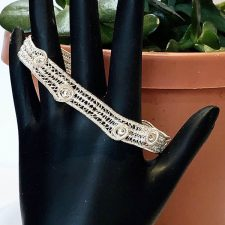 woven silver bangle and plants