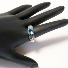 Silver pierced ring with blue topaz