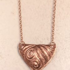 Hammered copper triangle necklace view 2