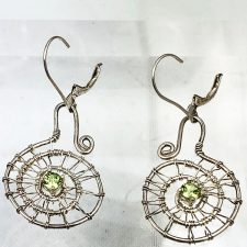 Woven silver spiral earrings with peridot