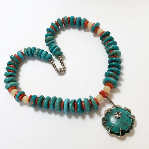 Turquoise necklace with coral and pendant