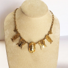 vermeil scarab necklace on a display