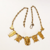 vermeil scarab necklace on white background