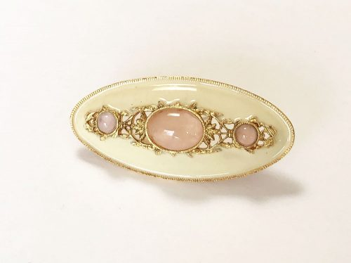 Enameled oval brooch with pink cabochons