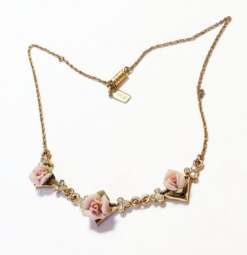 1928 gold tone necklace with roses