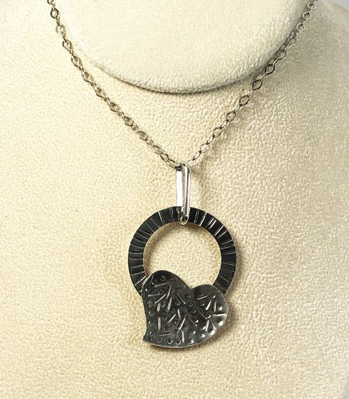 Sterling silver heart and ring pendant